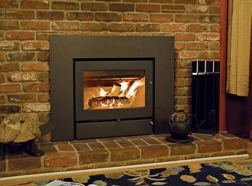 Jetson green energy efficient wood stoves by mors for Modern wood burning insert
